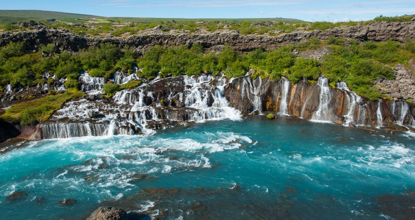 Hraunfossar is a very beautiful Icelandic waterfall in the west of the island. It comes from the lava field and pours into the Hvita river with a incredibly blue water. Long exposure.